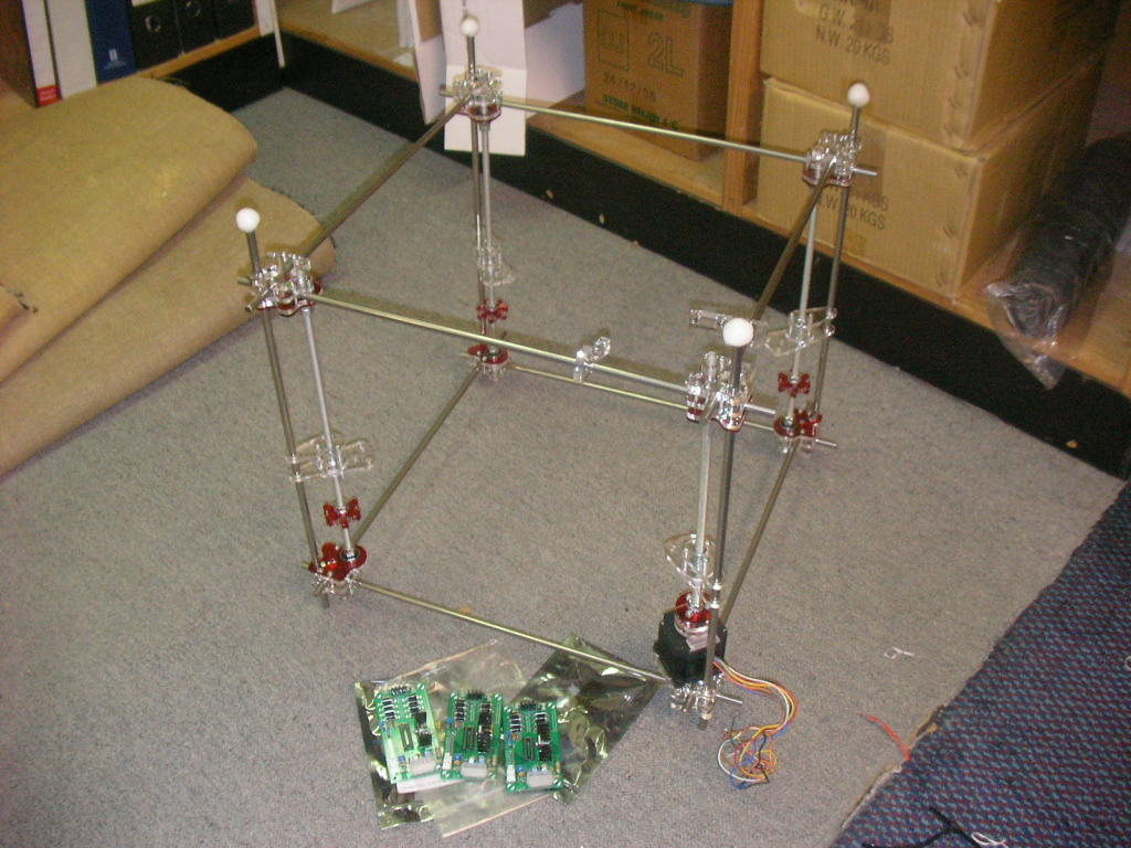A picture of my RepRap with the top frame in place and the three Stepper Motor Controller PCBs